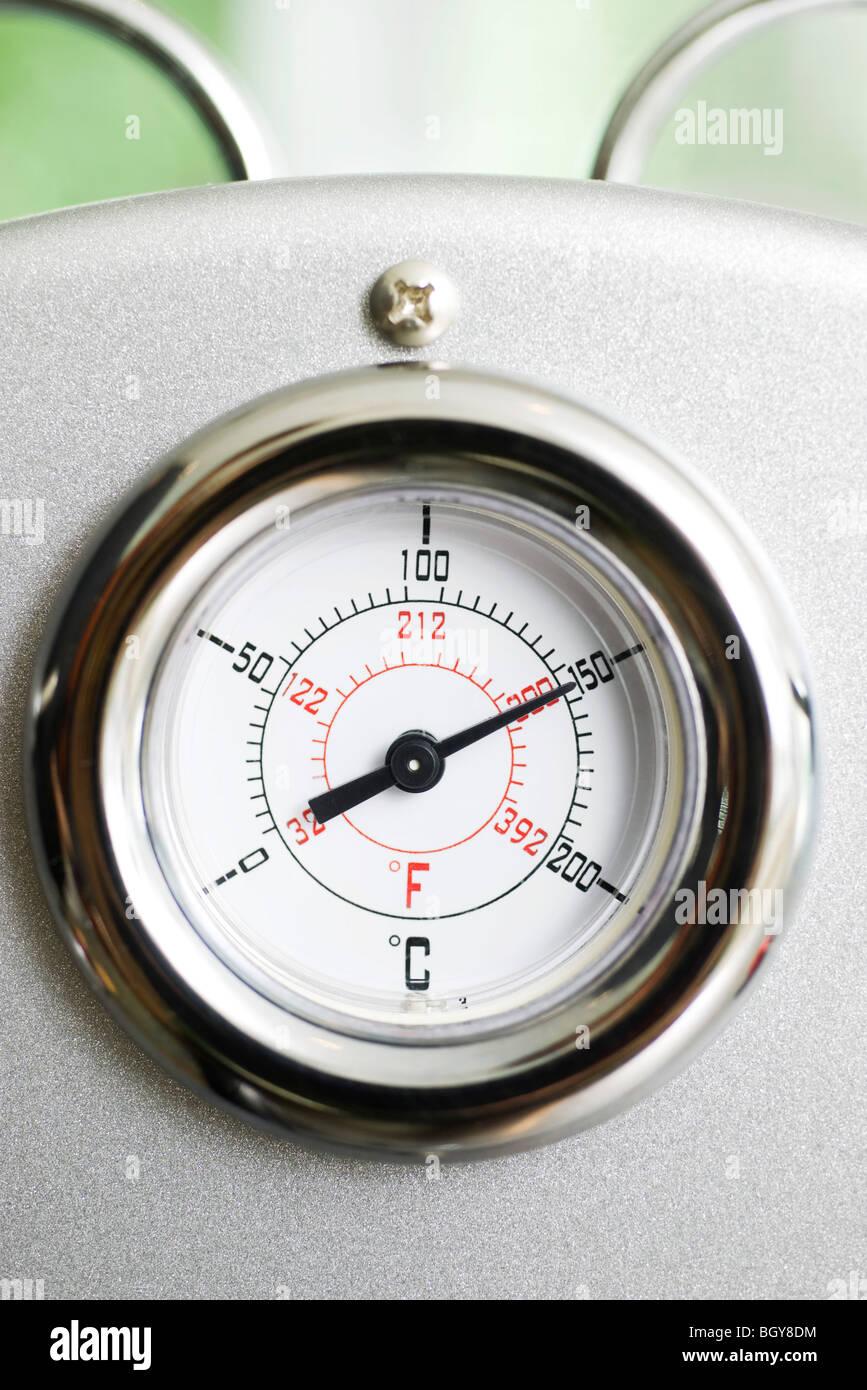 Temperature gauge on espresso machine - Stock Image