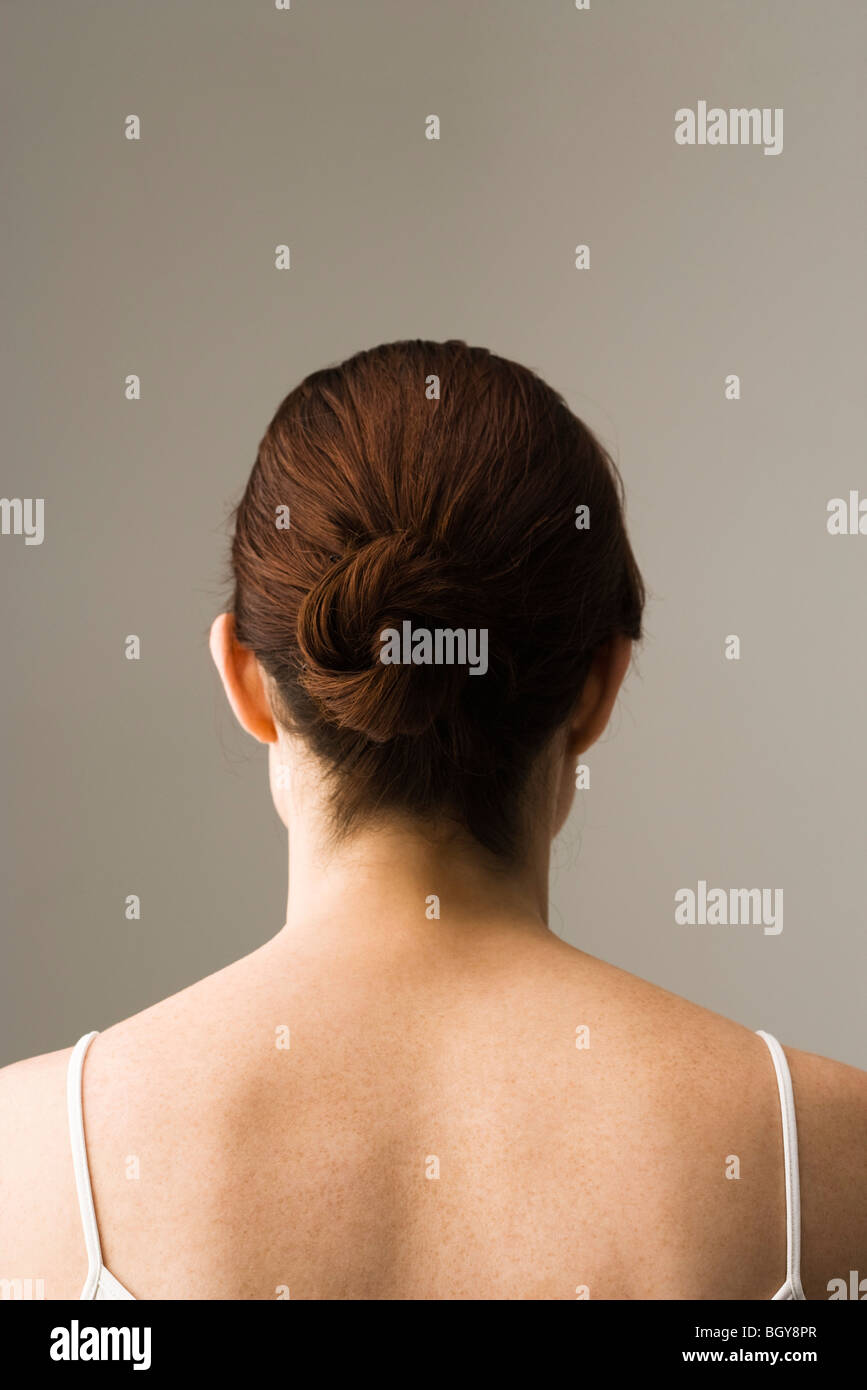 Woman with hair arranged in chignon, rear view Stock Photo