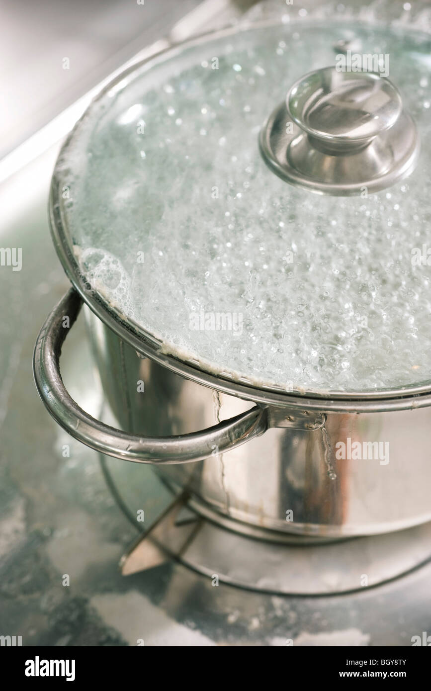 Water boiling in pot - Stock Image