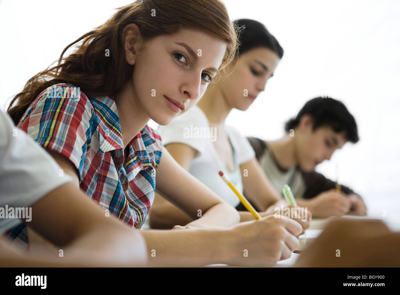 High school students busy with classwork - Stock Image