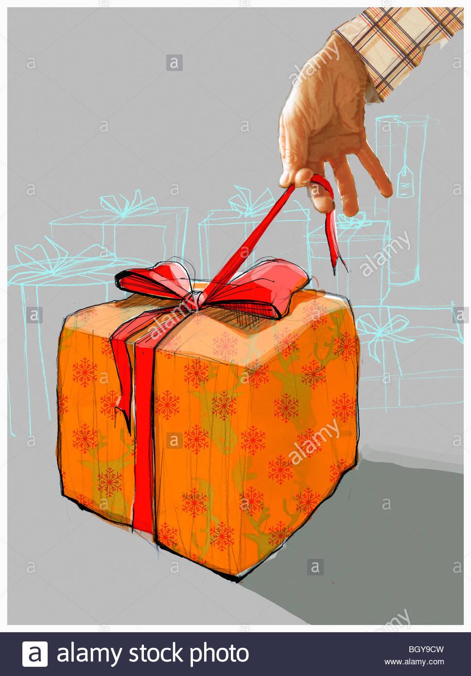 Man opening gift Stock Photo