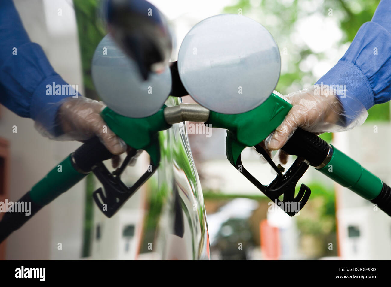 Refueling vehicle at gas station - Stock Image