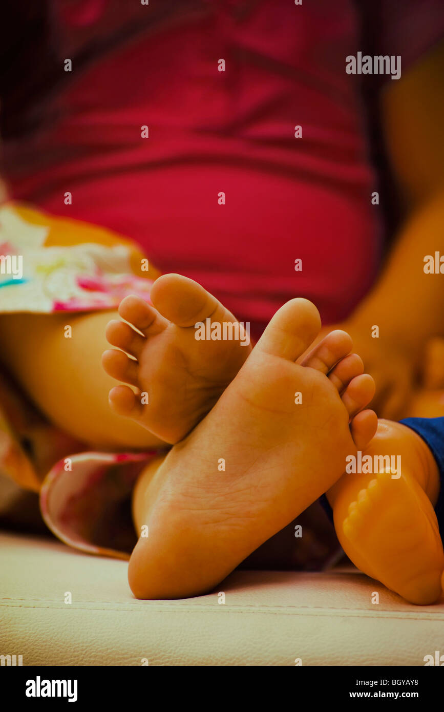 Soles of child's bare feet - Stock Image