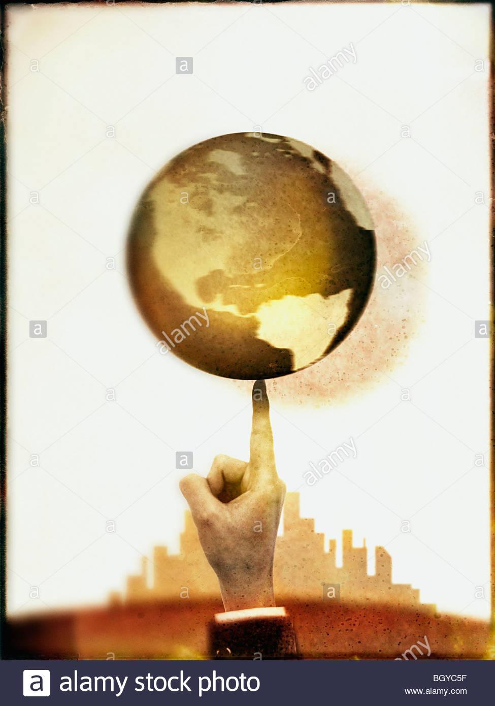 Businessman spinning globe - Stock Image