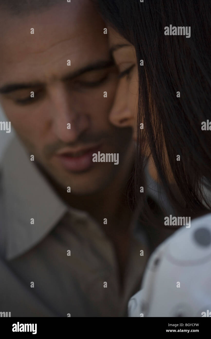 Couple touching foreheads, close-up - Stock Image