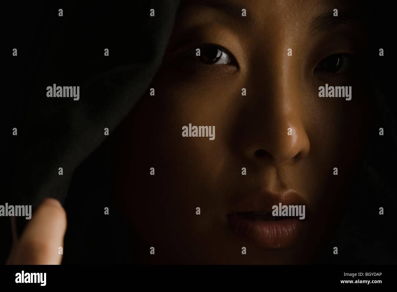 Woman wearing hood, close-up - Stock Image