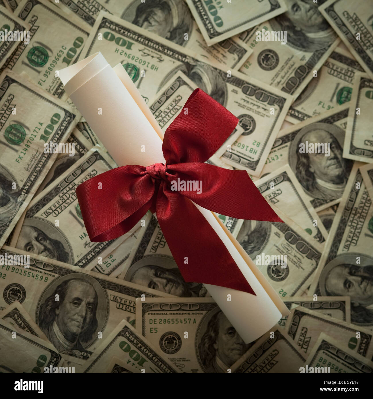 Diploma and money - Stock Image