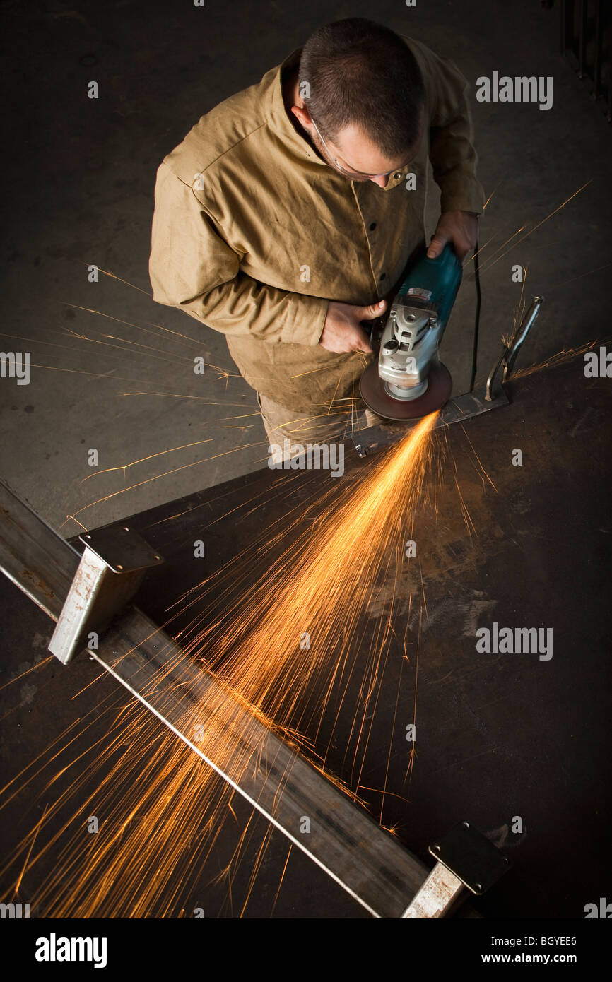 Steel worker in metal shop - Stock Image