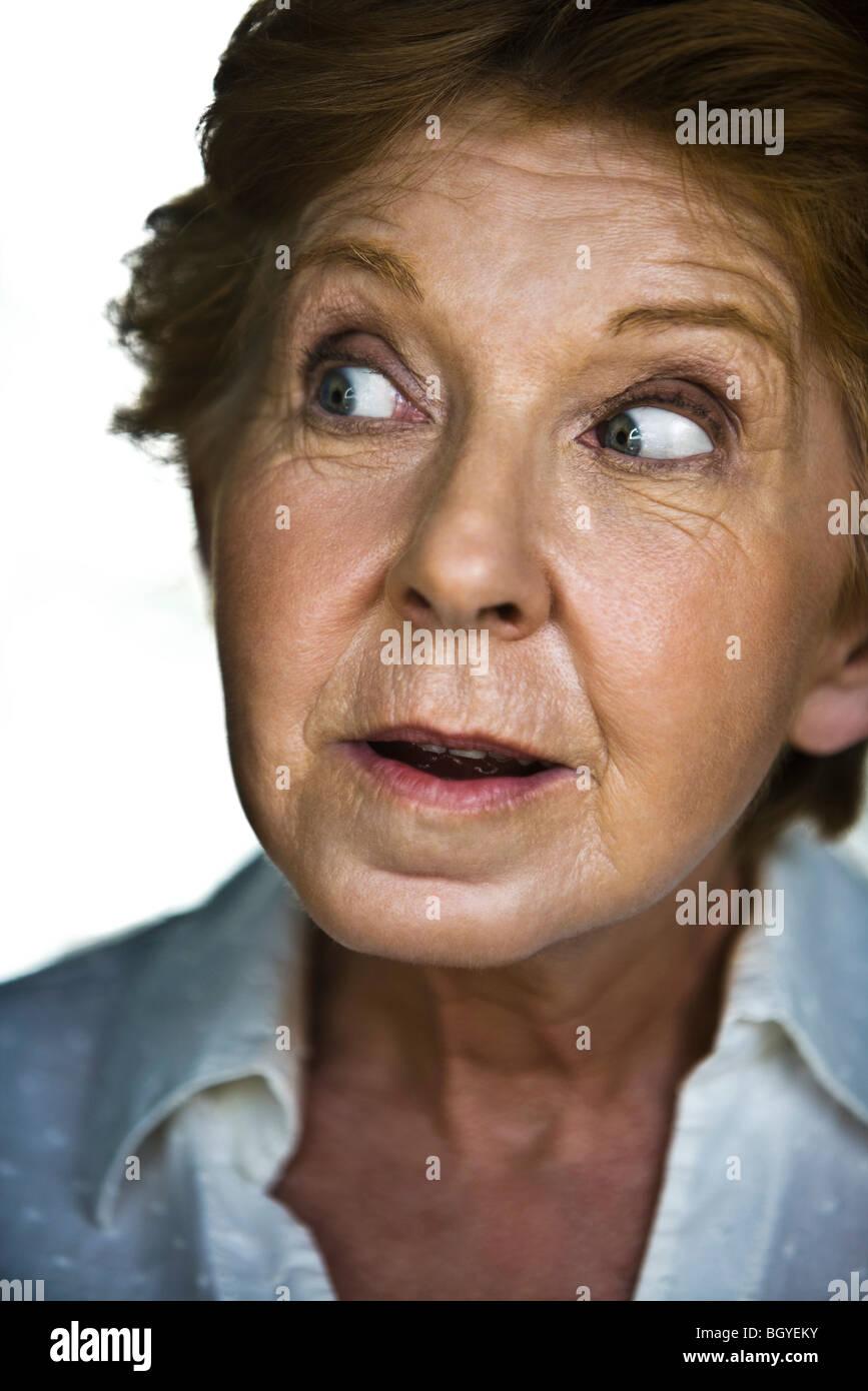 Senior woman displaying look of surprise - Stock Image