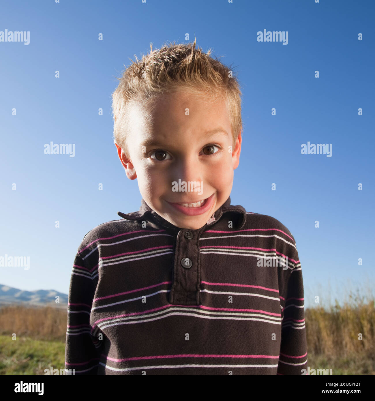 Young boy with goofy expression - Stock Image