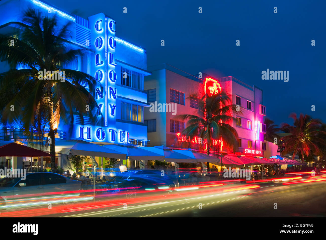 Illuminated buildings and car lights at night - Stock Image