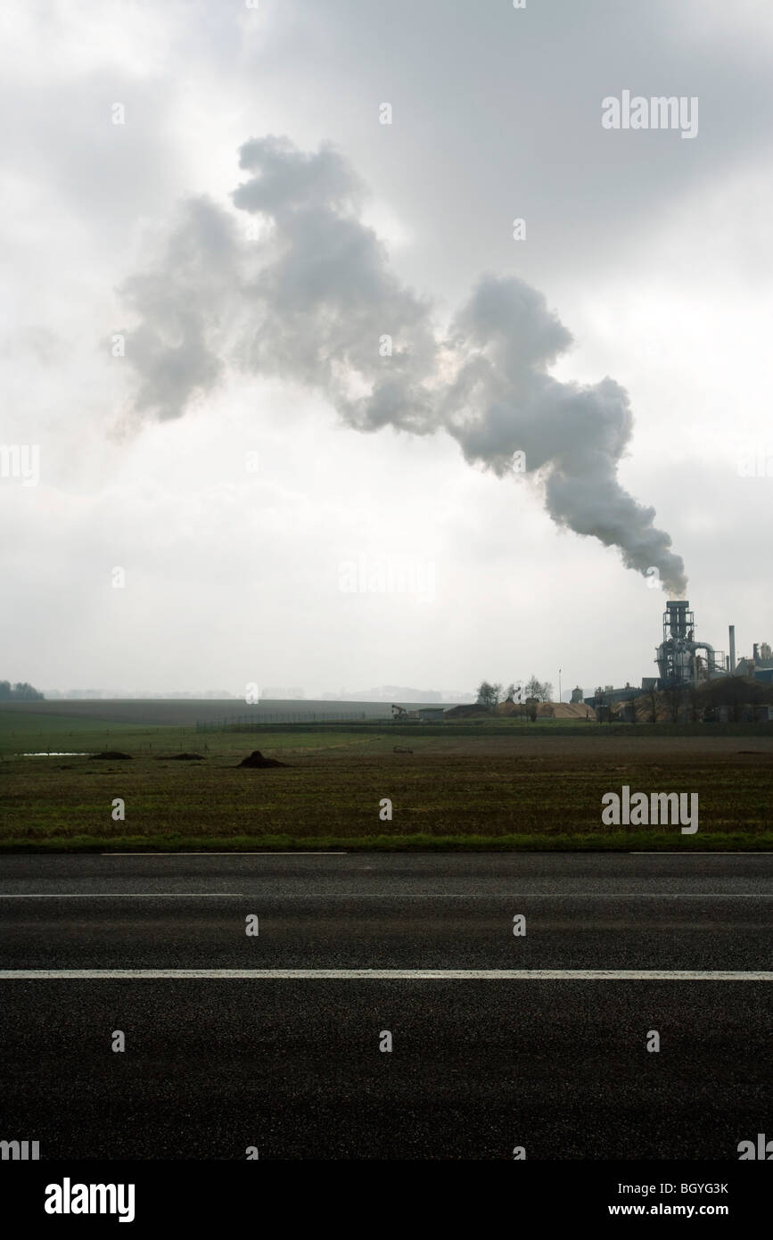 Smoke plume above factory - Stock Image