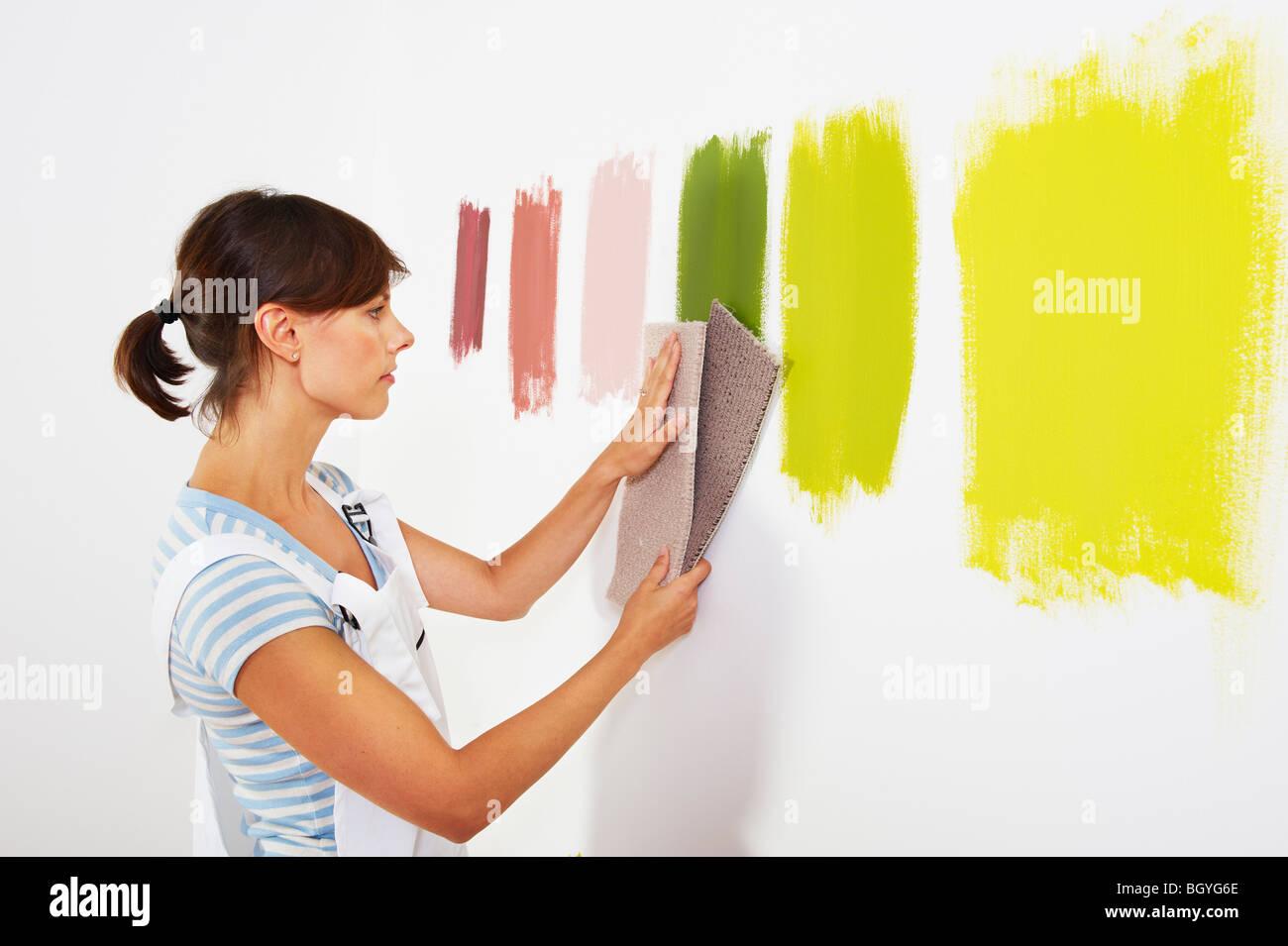 Woman looking at carpet samples. - Stock Image