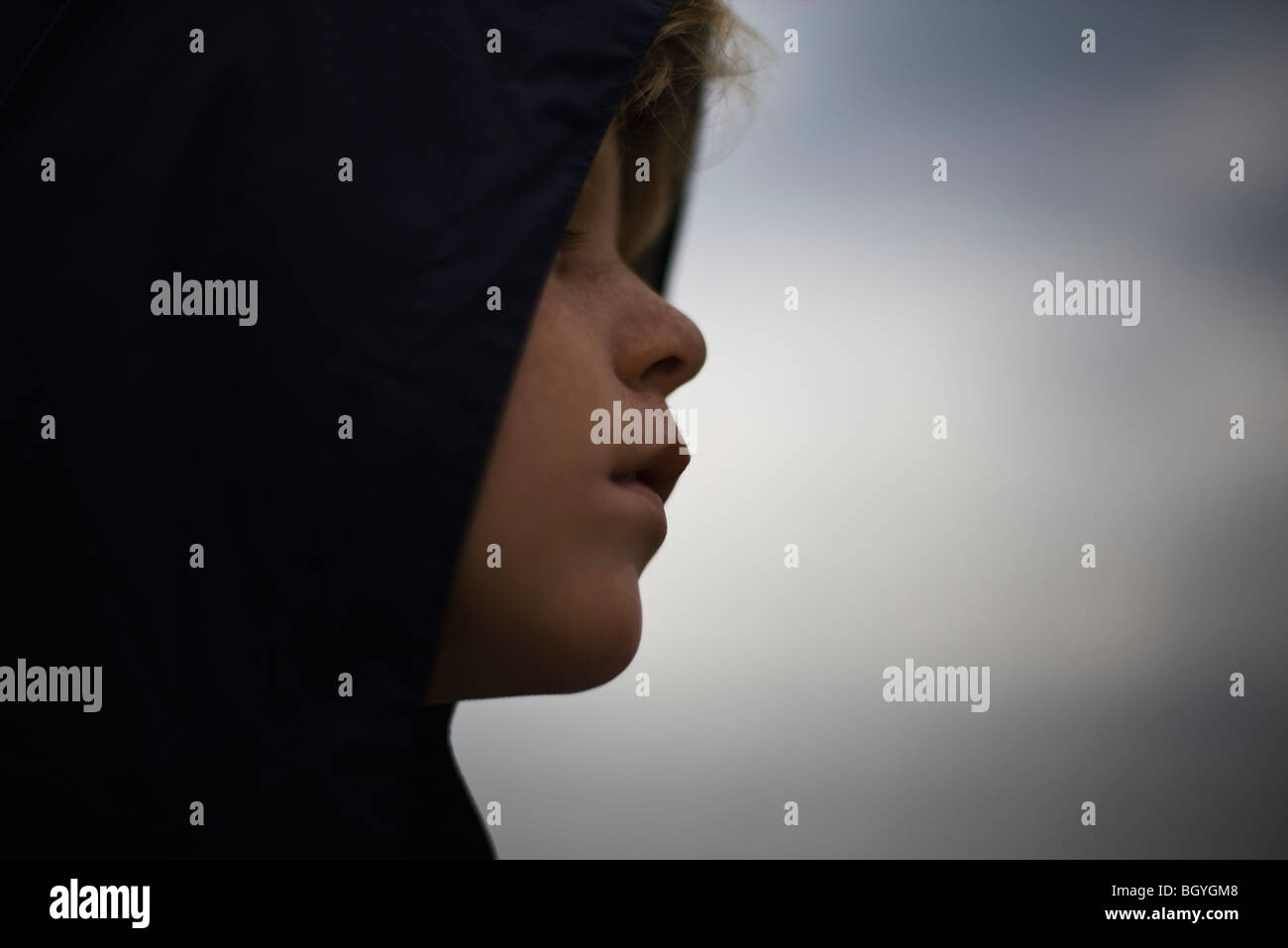 Boy looking away contemplatively - Stock Image