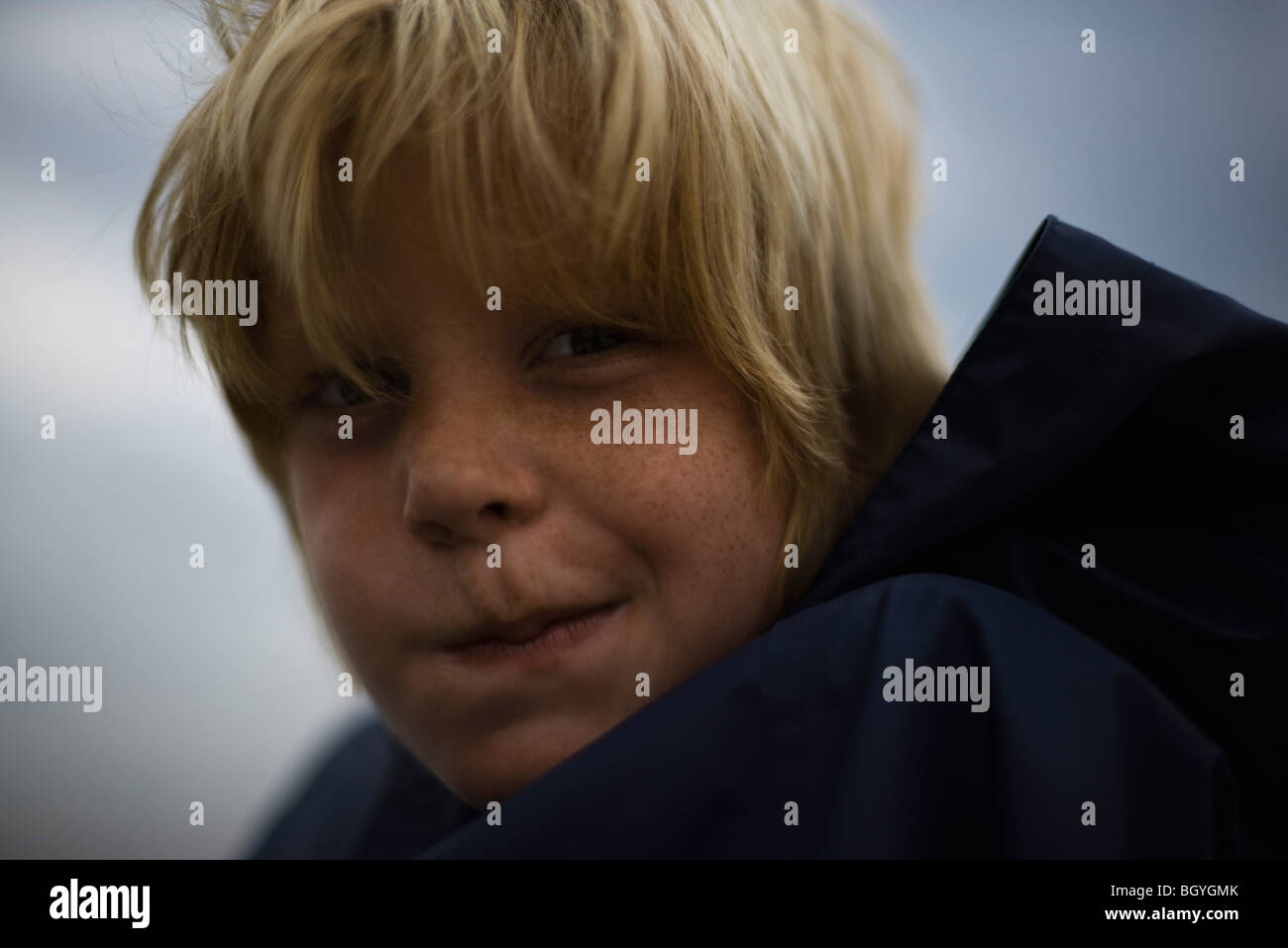 Boy frowning, portrait - Stock Image