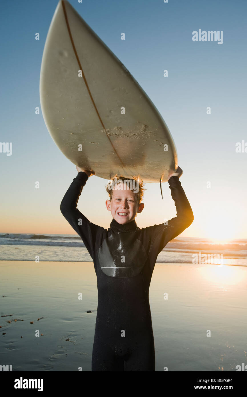 Child holding surfboard - Stock Image
