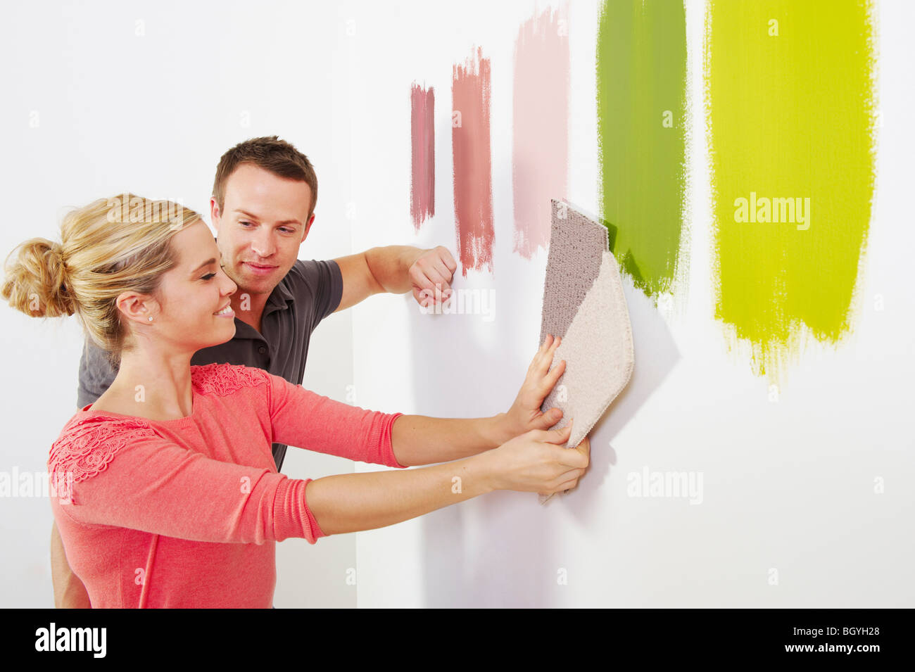 Couple looking at carpet samples. - Stock Image