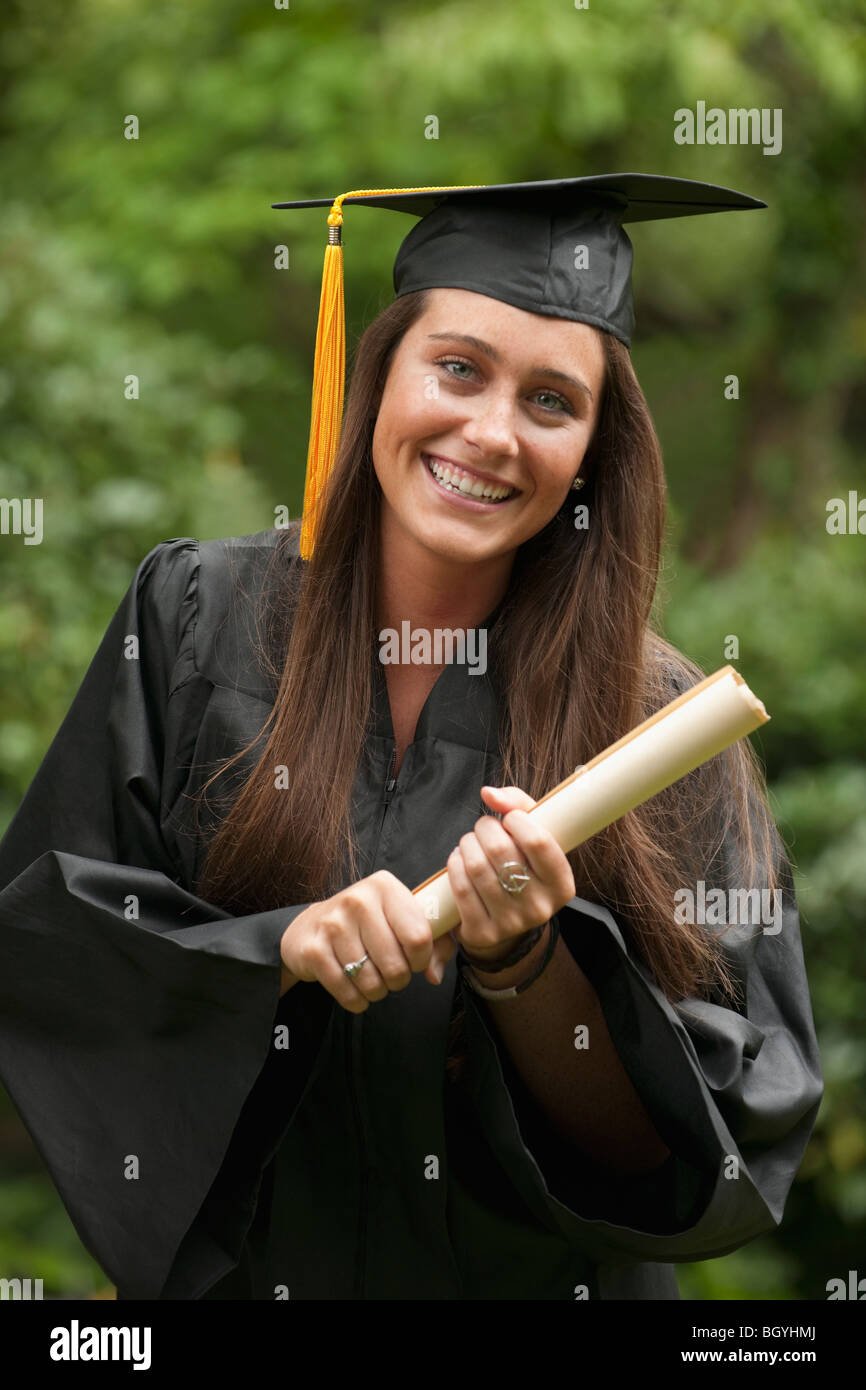 Graduate with diploma - Stock Image