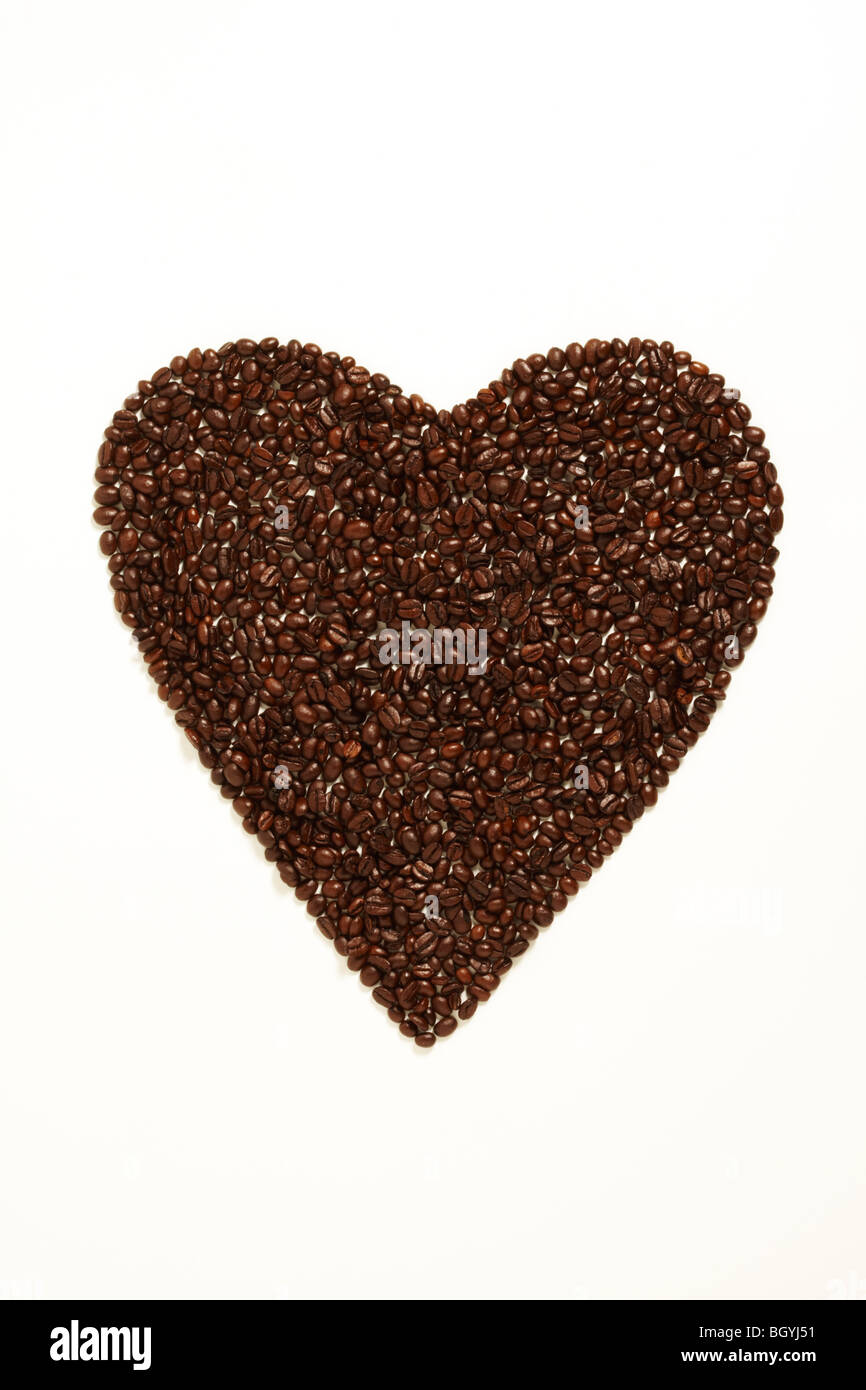 Coffee Beans Foaming a Heart Shape Symbolizing Love - Stock Image
