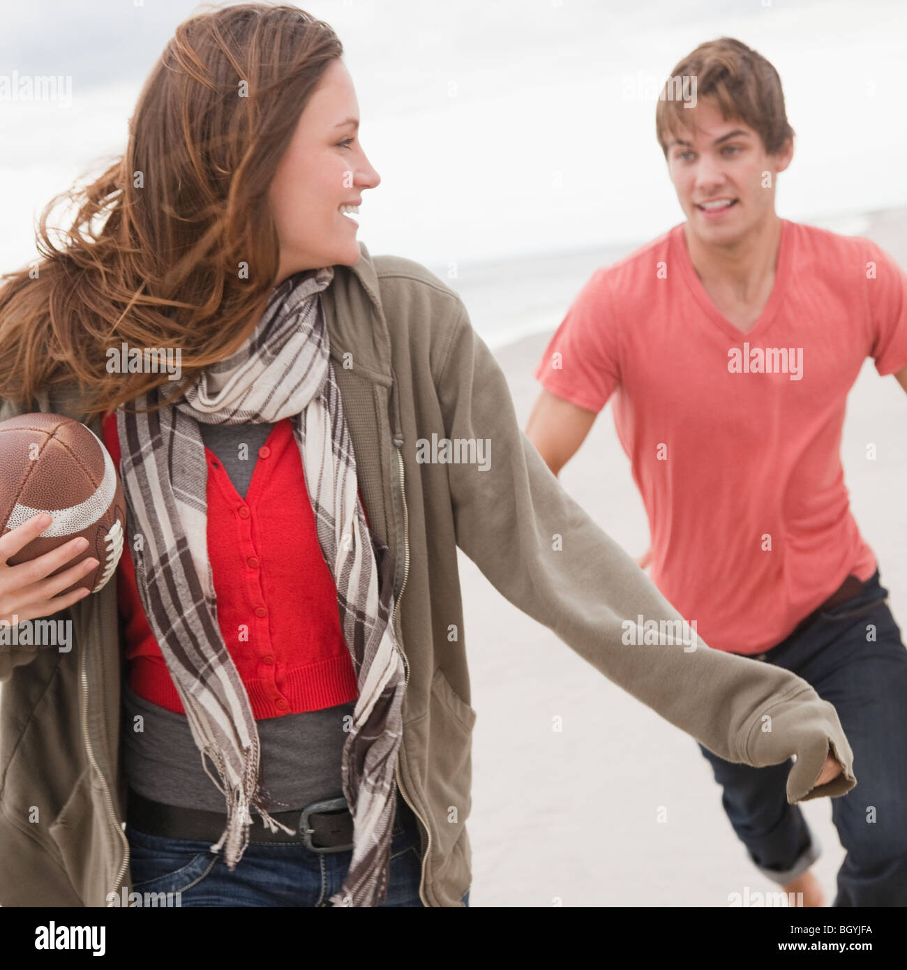 Couple playing football - Stock Image