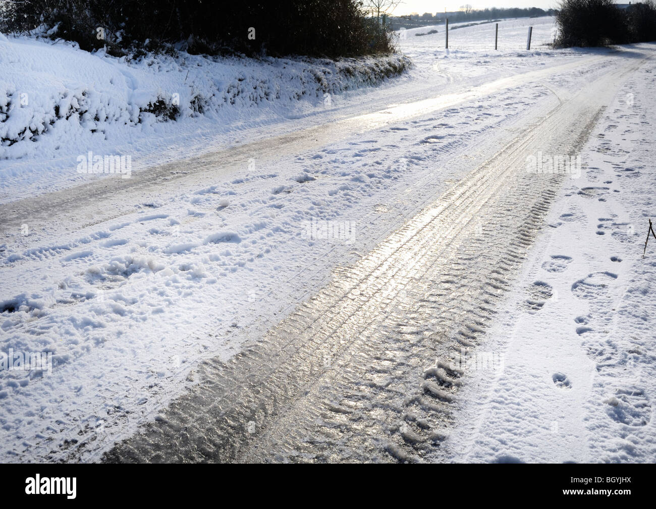 Black ice creates hazardous conditions for drivers - Stock Image
