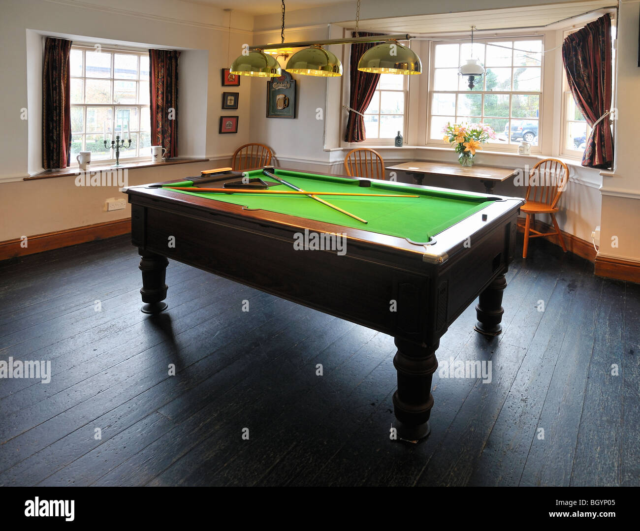 A pool table in a pub bar - Stock Image