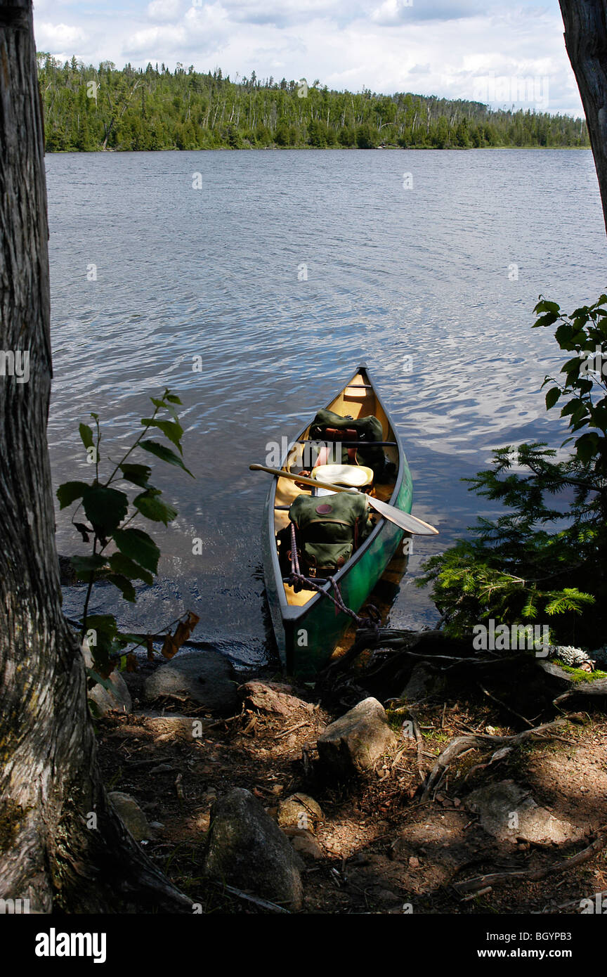 Canoe tied to shore at a campsite in the Boundary Waters Canoe Area Wilderness - Stock Image