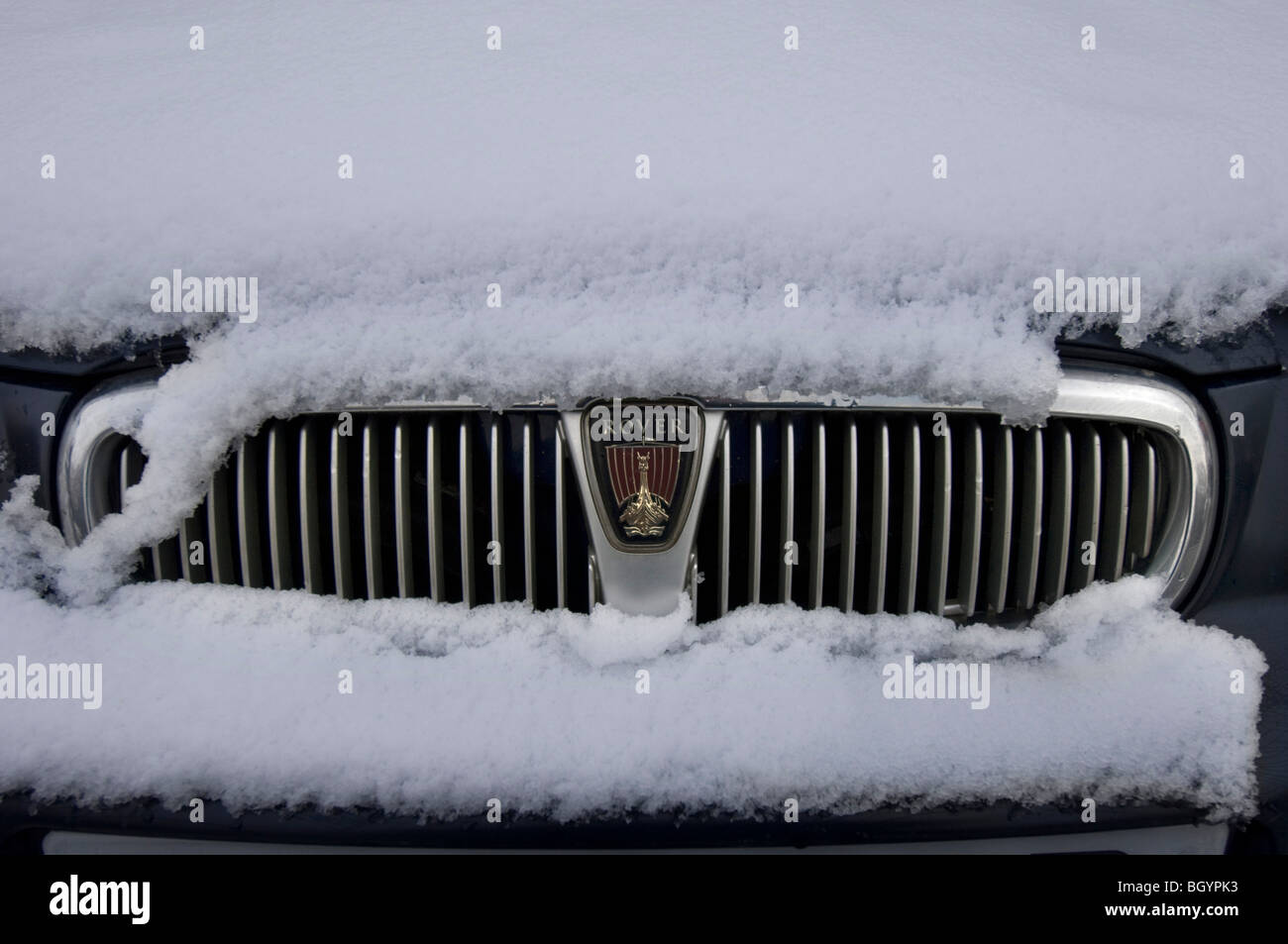 A Rover car in the snow, front view - Stock Image