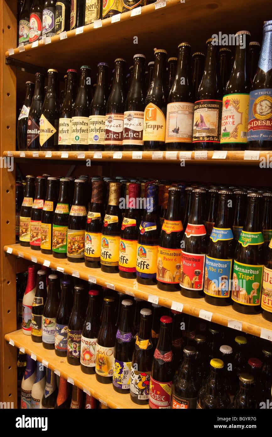 Belgian Beers on shelves in specialist shop in Bruges, Belgium - Stock Image