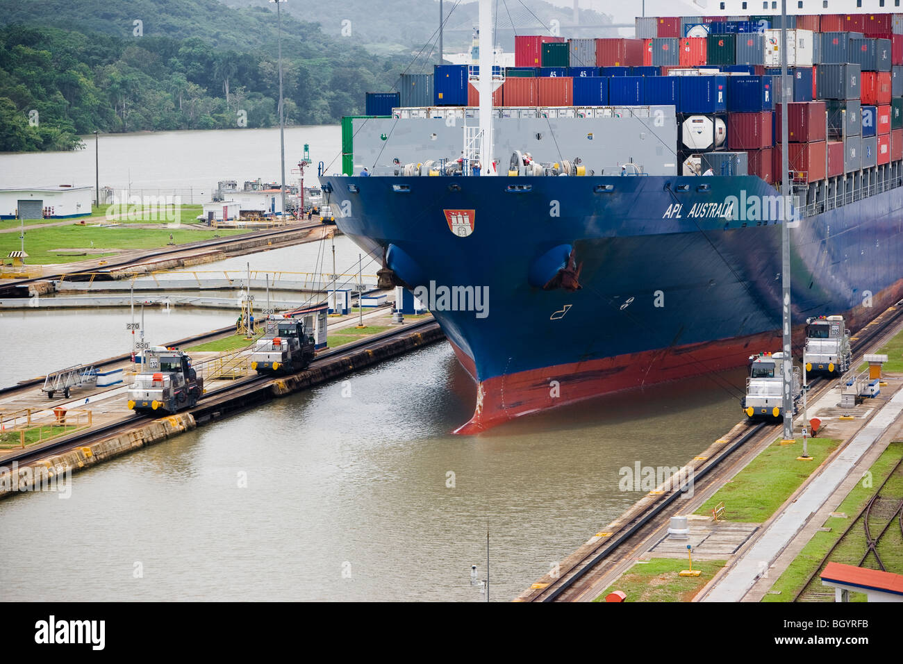 Cargo ship entering the Panama Canal at Miraflores Locks, Panama City, Central America - Stock Image