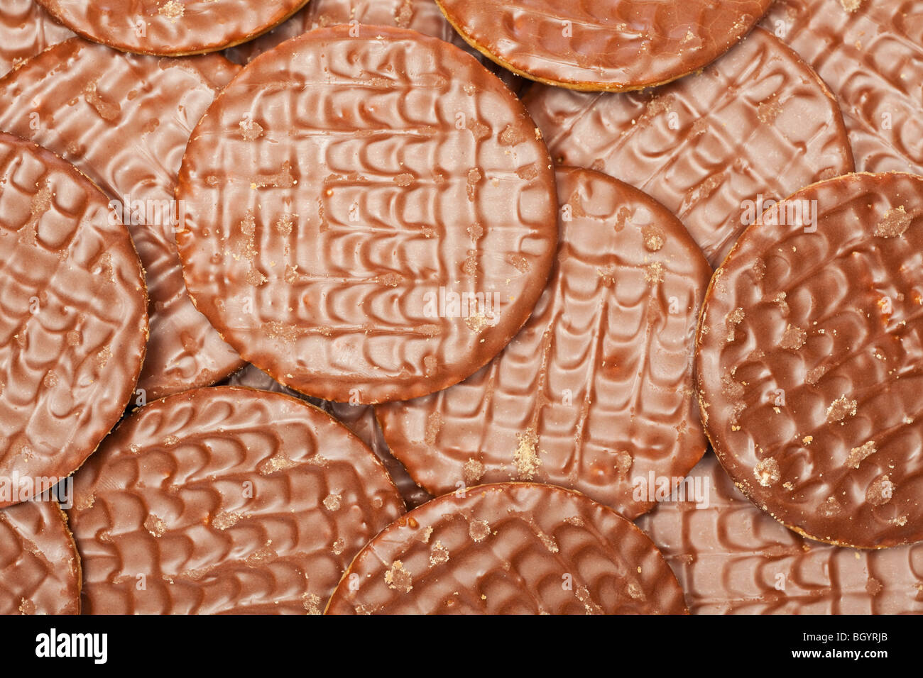 Close up group of milk chocolate digestive biscuits - overhead - Stock Image