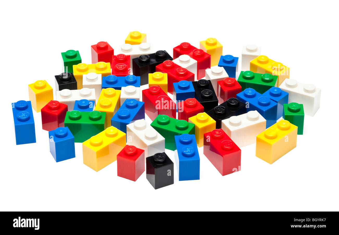 Lego pieces and building blocks on white - Stock Image