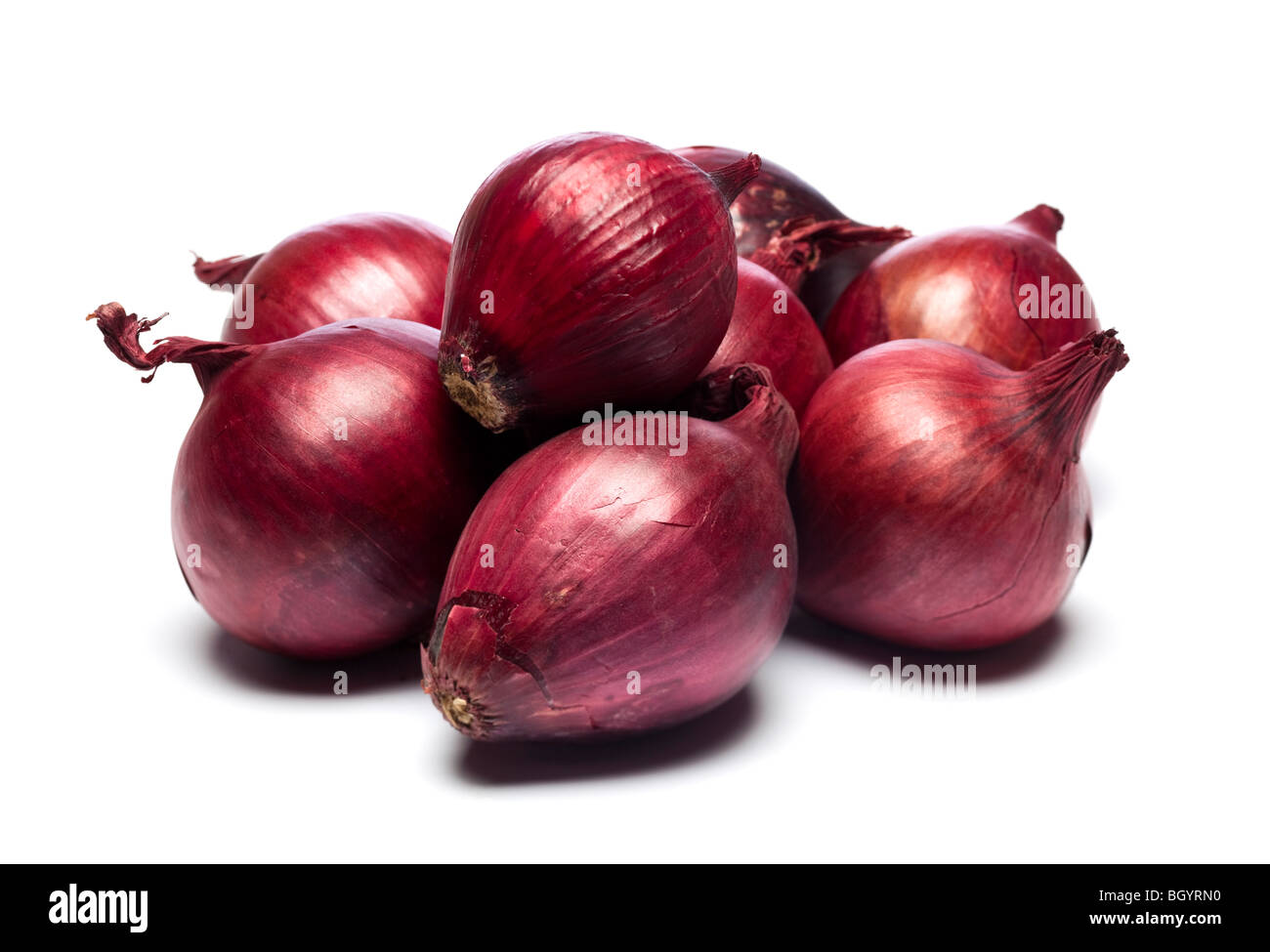 Studio shot of Red Onion pile - Stock Image