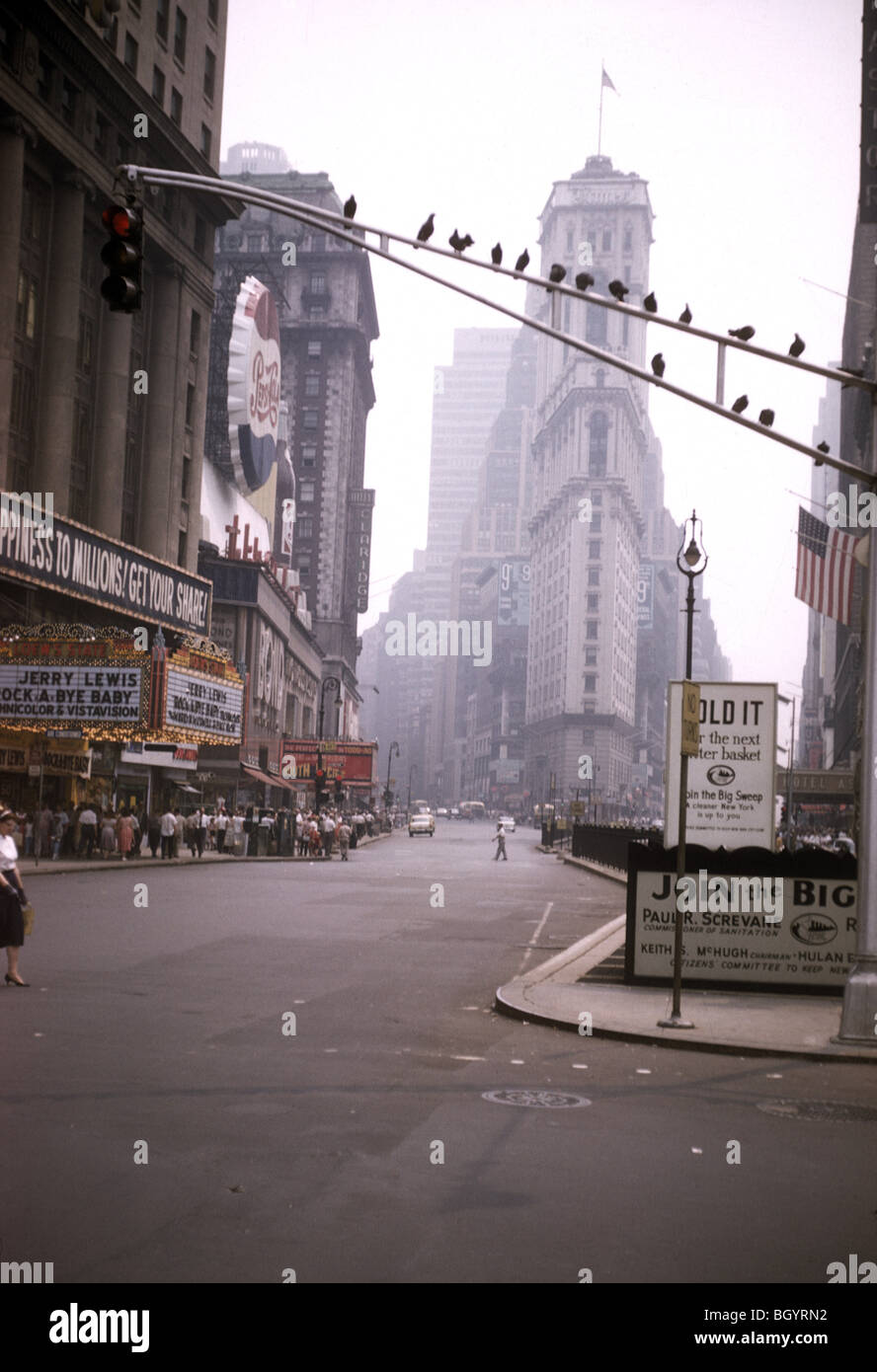 Times Square, where a Jerry Lewis film is playing and a crowd is lined up outside, is a view of New York City during - Stock Image