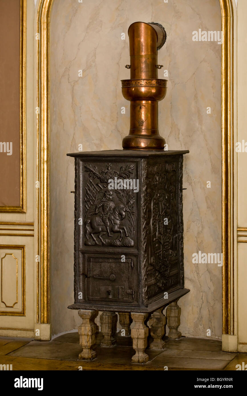 Old woodburning stove with copper vent pipe - Stock Image