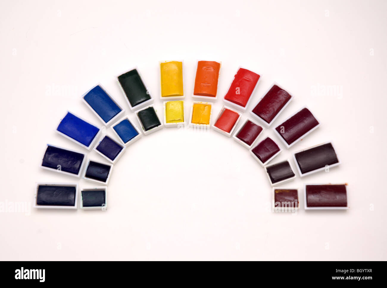 Rainbow of half and full watercolour paints - Stock Image