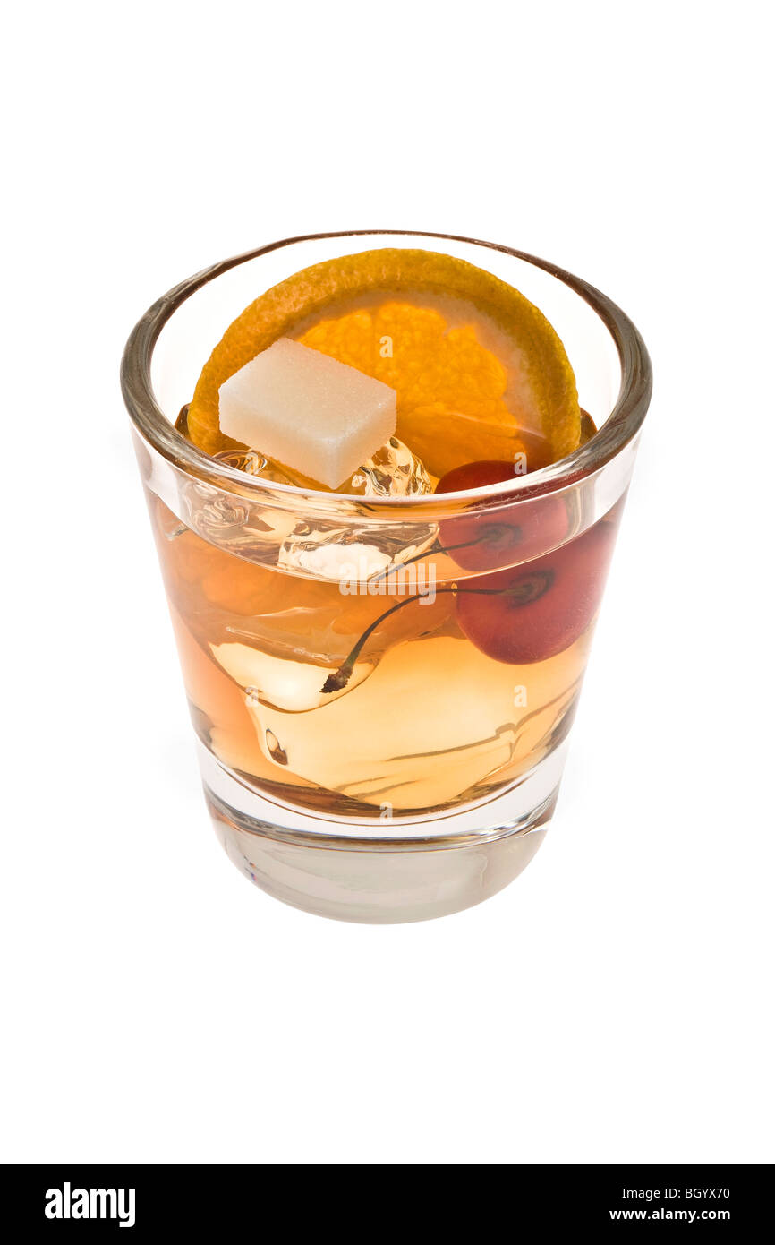 Old fashioned mixed drink with sugar cube on a white background Stock Photo