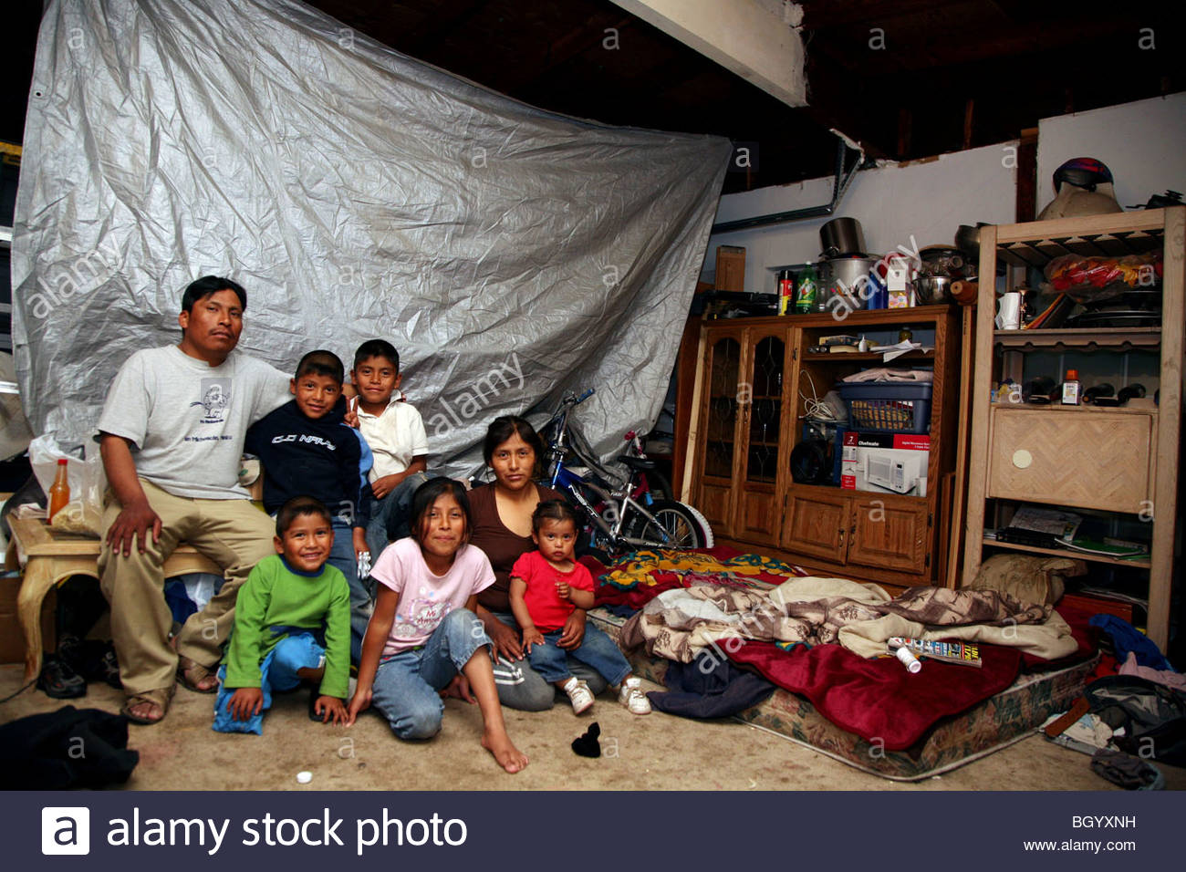 Immigrant Mexican Family Living In A Garage In California
