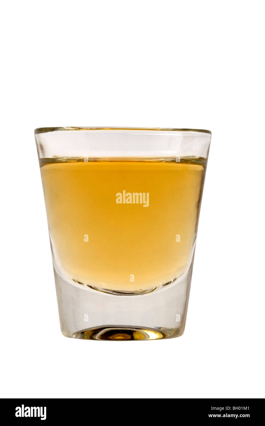 Whiskey neat in shot glass on white background - Stock Image