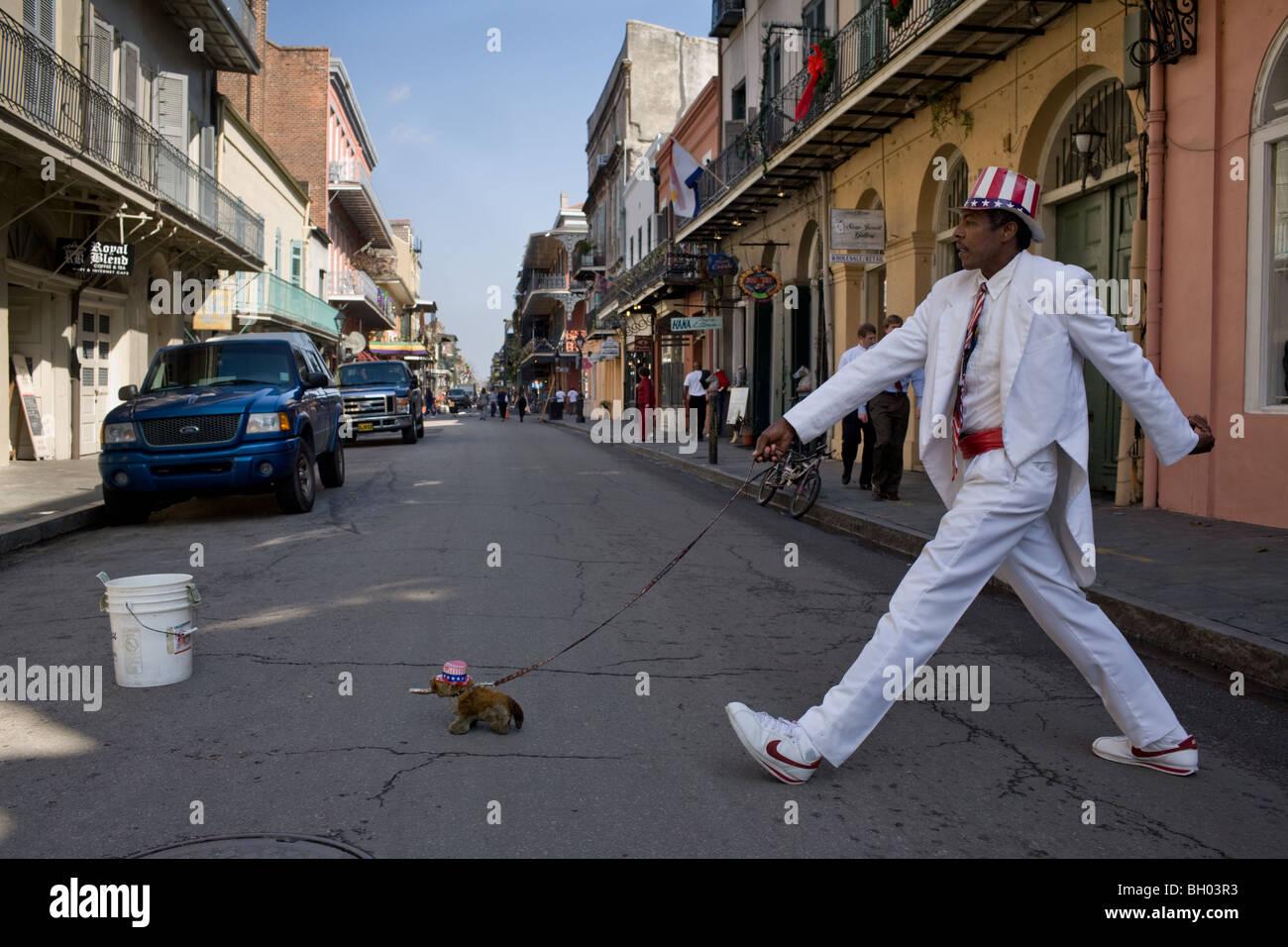 A mime street performer entertains, Bourbon Street, French Quarter, New Orleans, Louisiana Stock Photo