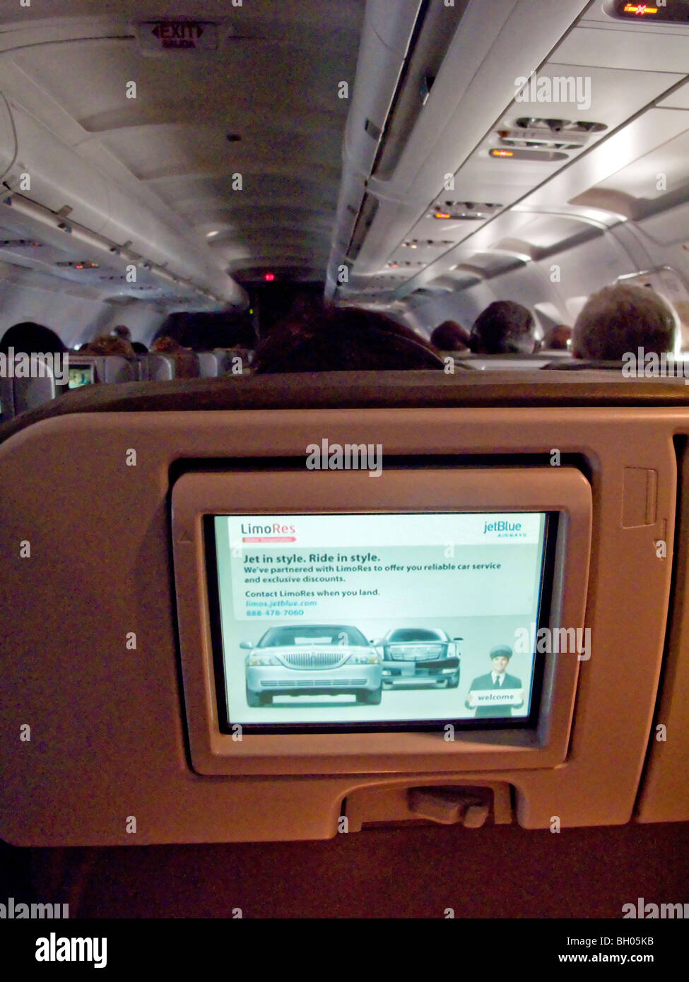 In-flight television entertainment for airline passengers' enjoyment on individual screens at their seats includes - Stock Image