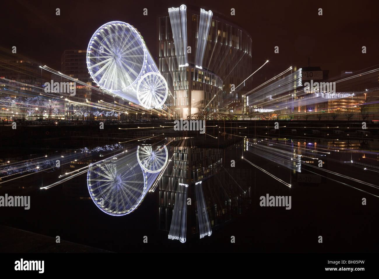Liverpool Merseyside England UK Britain. Liverpool One Wheel and waterfront reflections zoomed across Salthouse - Stock Image