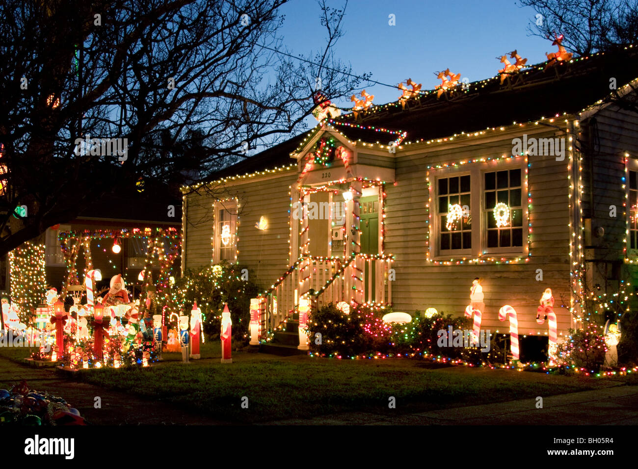 tacky christmas decorations decorating the front of a residential home stock image