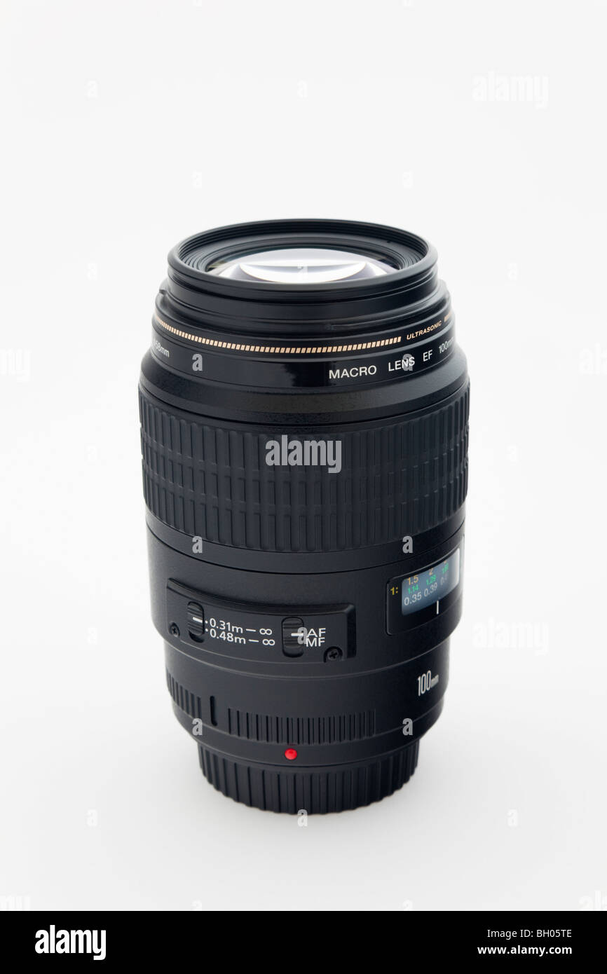 Unbranded Canon 100mm macro camera lens on a plain white background - Stock Image
