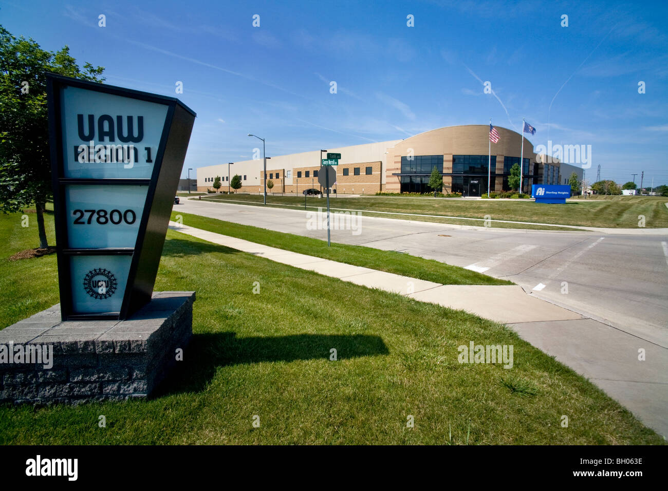 Next to a United Auto Workers local a Detroit, Michigan, auto parts factory stands ironically idle during high unemployment. - Stock Image