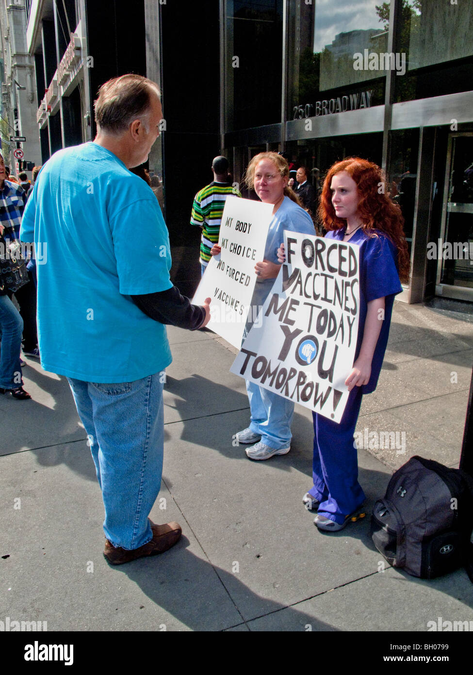 Health care workers at a NY City clinic hold a sidewalk protest against compulsory inoculations of H1N1 swine flu - Stock Image