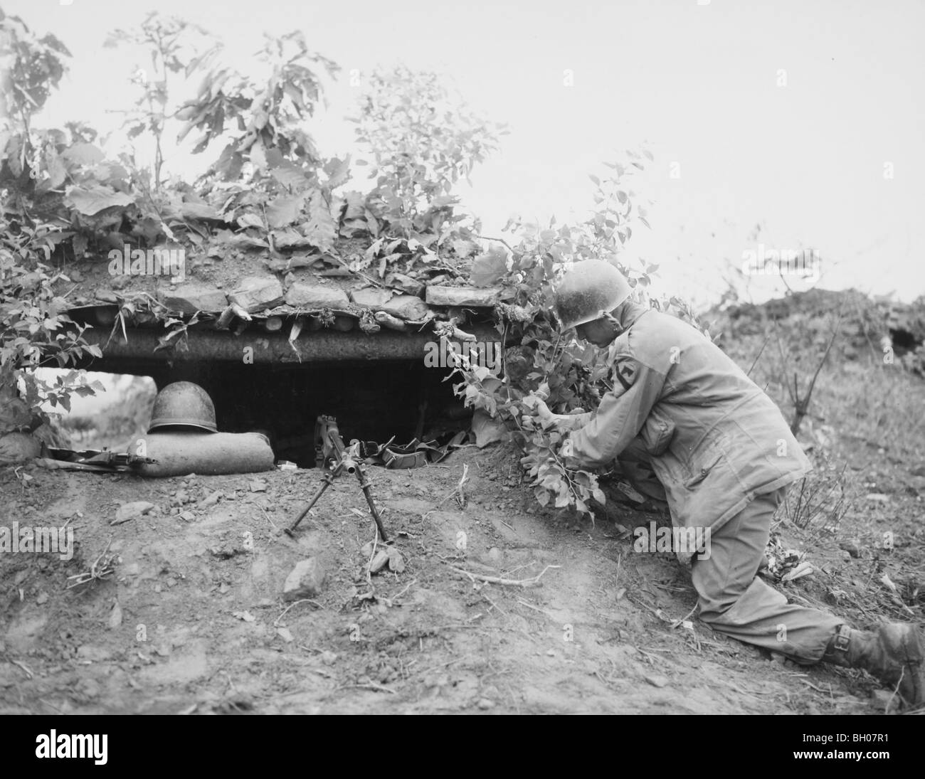 PFC William G. Young, 8th Cavalry, First Cavalry Div puts the finishing touches on the 'Wyoming' line North - Stock Image