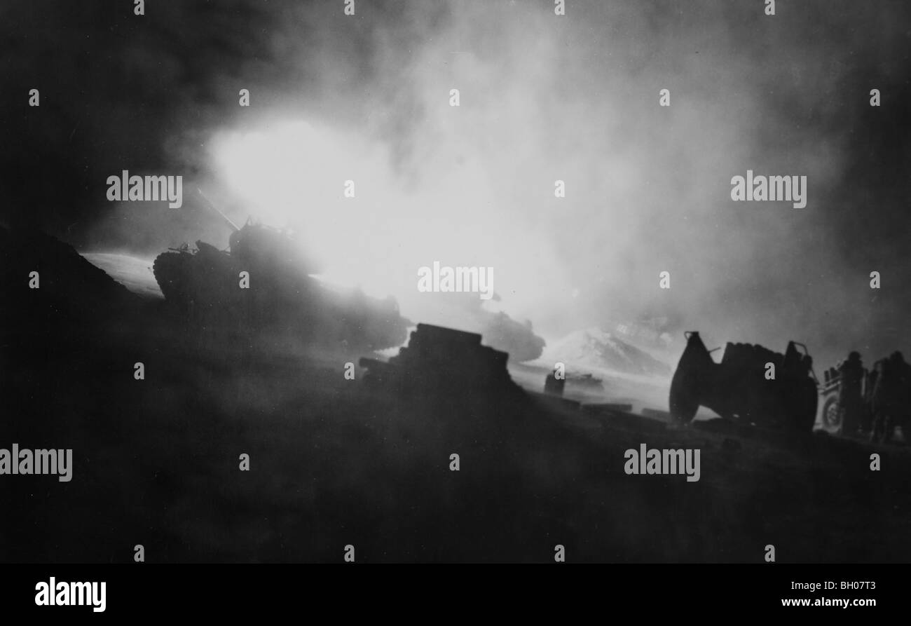 'Dog' Company, 1st Tank Battalion, cut with their 90mm guns during night firing at enemy position in front - Stock Image