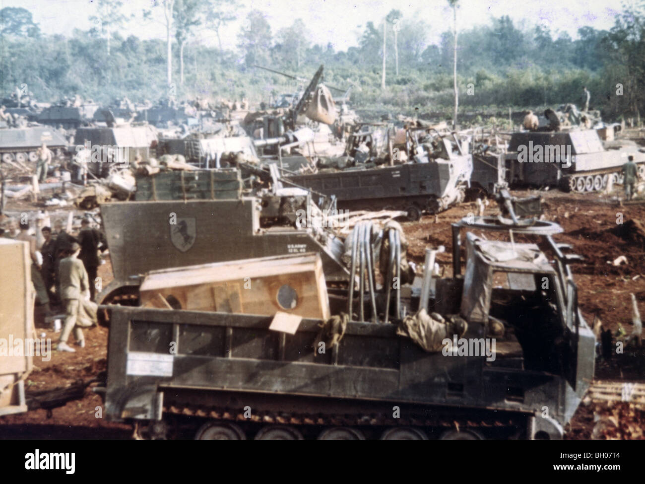 """Men and vehicles from Troop """"E"""", 11th Armored Cavalry, set up a night defensive position during the 1970 invasion Stock Photo"""