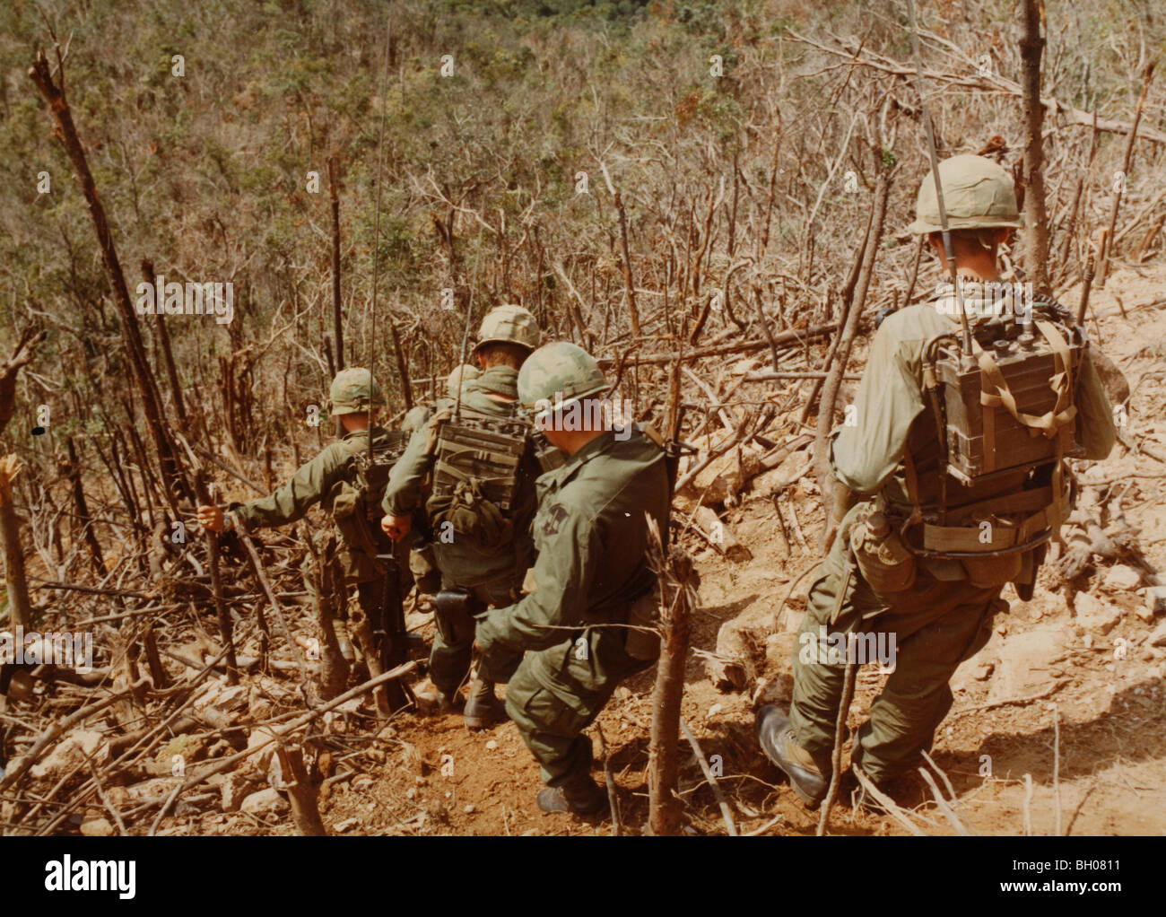 Troops of the C Co, 1st Battalion, 50th Mechanized, 1st Air Cavalry Division, move down the hillside - Stock Image